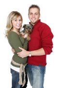 young couple with yorkie pupp