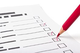Checklist with red pencil marks