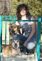 Girl with her adopted dogs